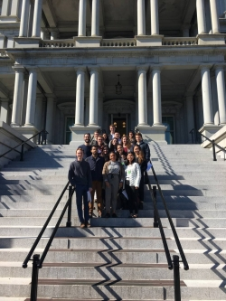 Sixteen Princeton students on the steps of the Eisenhower Executive Office Building.