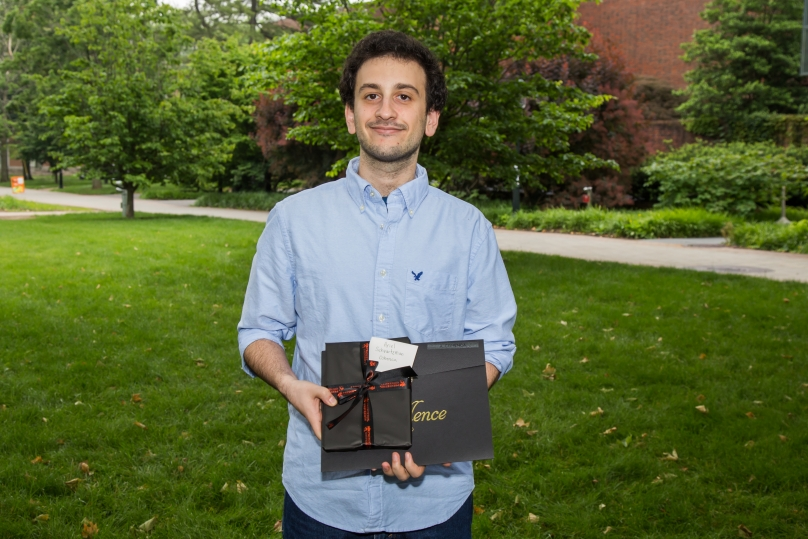 Ariel Schvartzman Cohenca stands with his Graduate Student Teaching Award